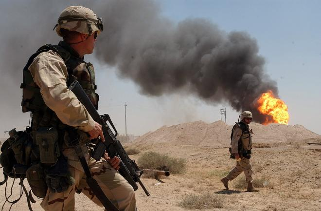 US troops watch burning oil fields in wake of US invasion in 2003