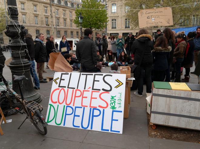 Elites cut off from people - protest sign in French Nuit Debout demonstrations