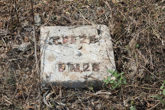 A stone in the middle of IDPs' former village to mark the railway track