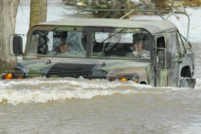 US troops driving through floods in Fort Ransom in 2009