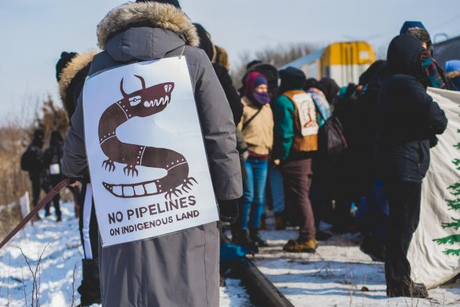 No Pipelines graphic on the back of land defender at blockade of railyard in Vaughan, Toronto, Ontario in February 2020. Photo by @jasonhargrove