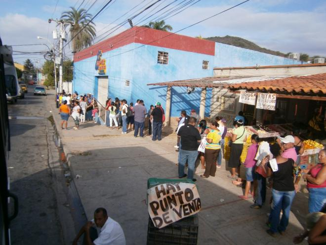 Shoppers waiting in line at a government-run MERCAL store.