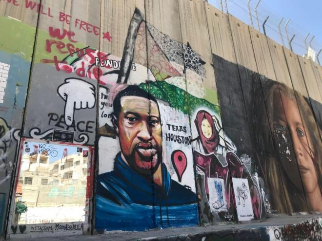 Taqi Spateen's first mural of George Floyd on the Israeli Separation wall in Bethlehem, occupied West Bank. Photo by Yumna Patel.