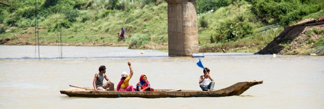 Protestors in a boat rally at Narmada Dam calling for full rehabilitation of affected communities