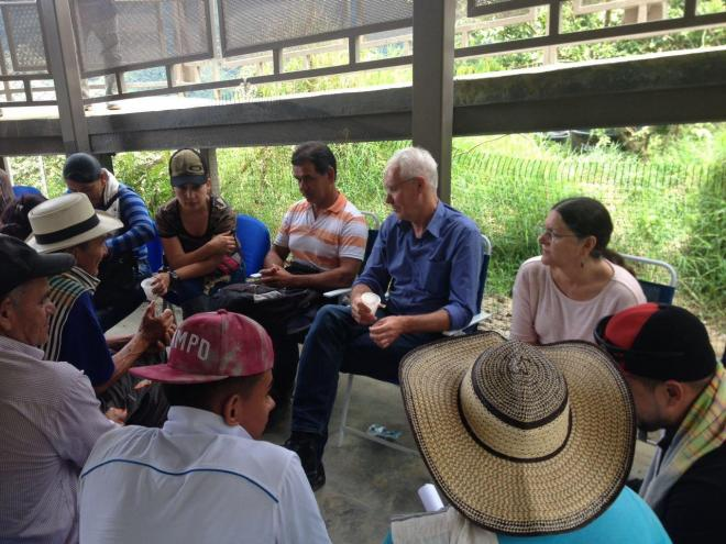 Martin and Coletta in a meeting with community leaders