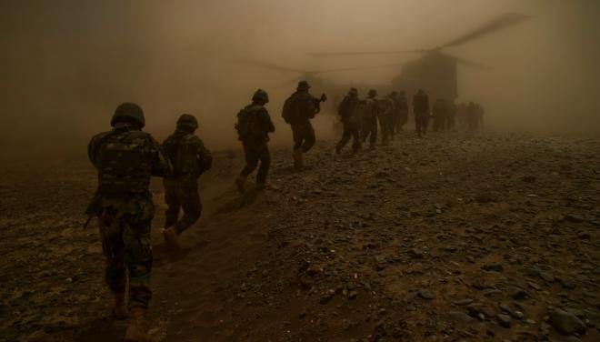 Afghan National Army commandos from the 3rd Commando Kandak and coalition forces board a CH-47 Chinook helicopter after completing a village clearing operation in Mya Neshin district,