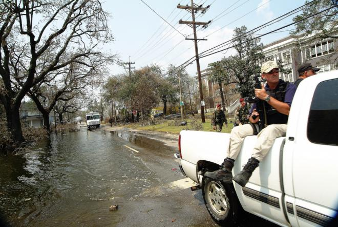 A caravan of various security forces cruises through the flooded streets of the 9th Ward distrtict of New Orleans, in the aftermath of Hurricane Katrina.