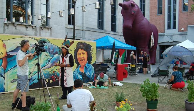 First nation spokesperson gives interview at Place Pasteur, Montreal.