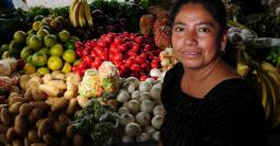 A woman attends her produce post in a market in zone 3, Guatemala City.