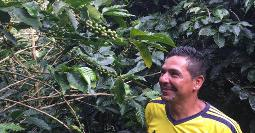 Ómar with his coffee plants