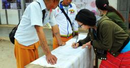 Voters checking off their names at polling booths at Wan Hai High School, Shan State
