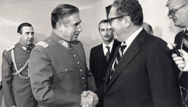 U.S. Secretary of State Henry Kissinger shaking hands with Pinochet in 1976